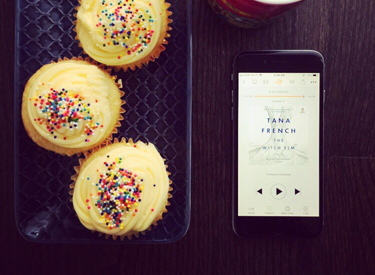 Three sprinkle cupcakes and an iPhone displaying Tana French's The Witch Elm in the Audible app